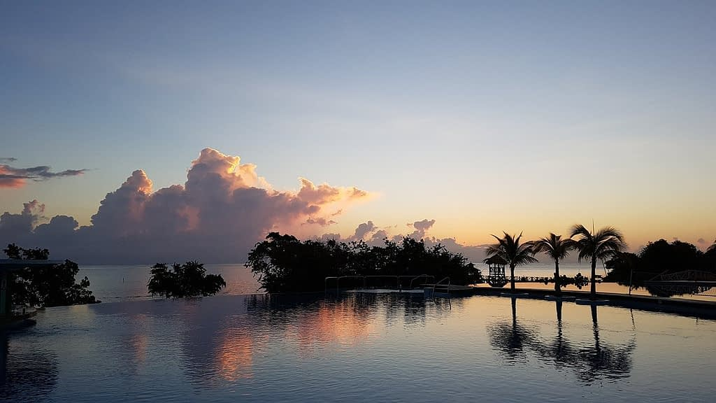 Jamaican sunrise and sky reflected in the water