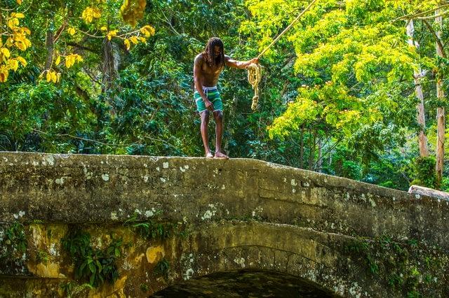 Alt-tag: A man standing on a stone bridge